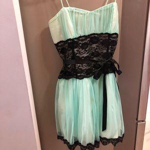 A sea foam colored foam formal dress